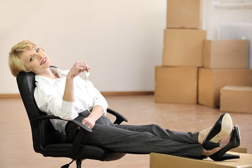 Business woman in new office after professional movers moved her in