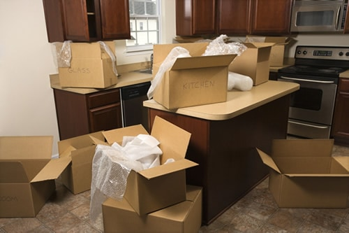 Residential home kitchen with moving boxes packed up