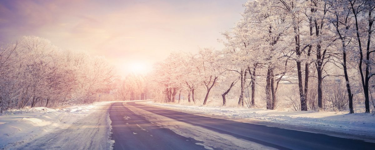 Sun rising behind a highway in the winter