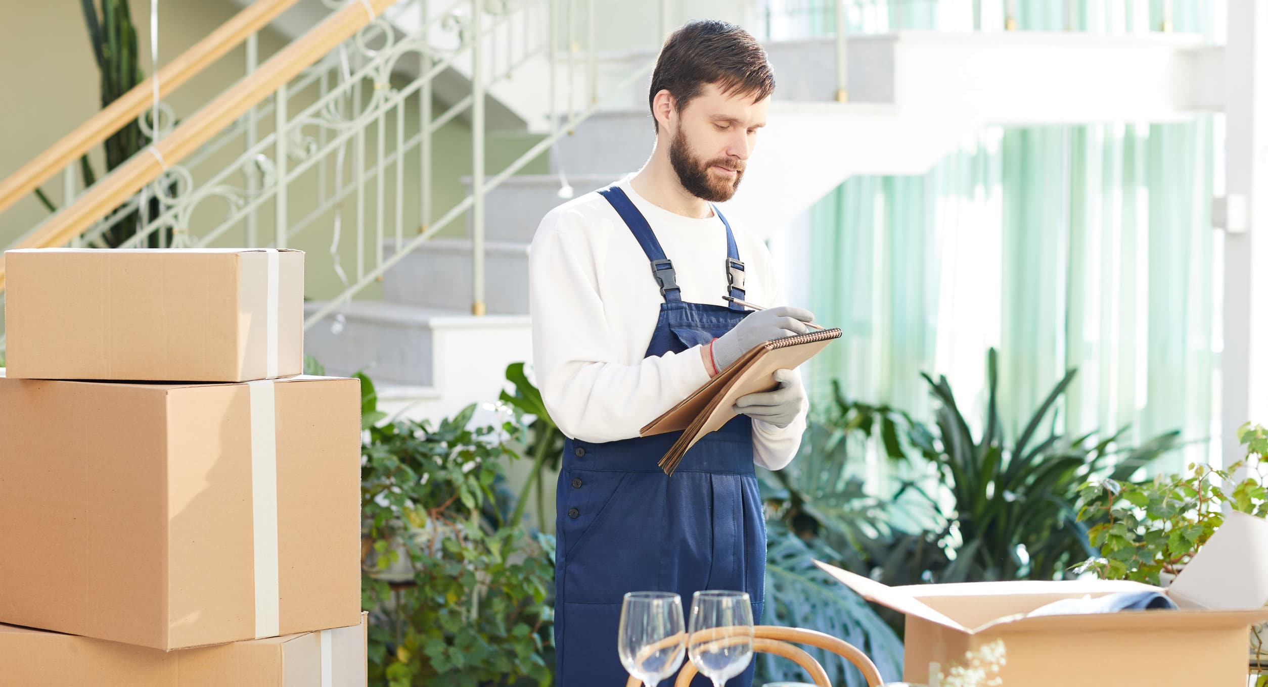 Moving company foreman writing information about delivery