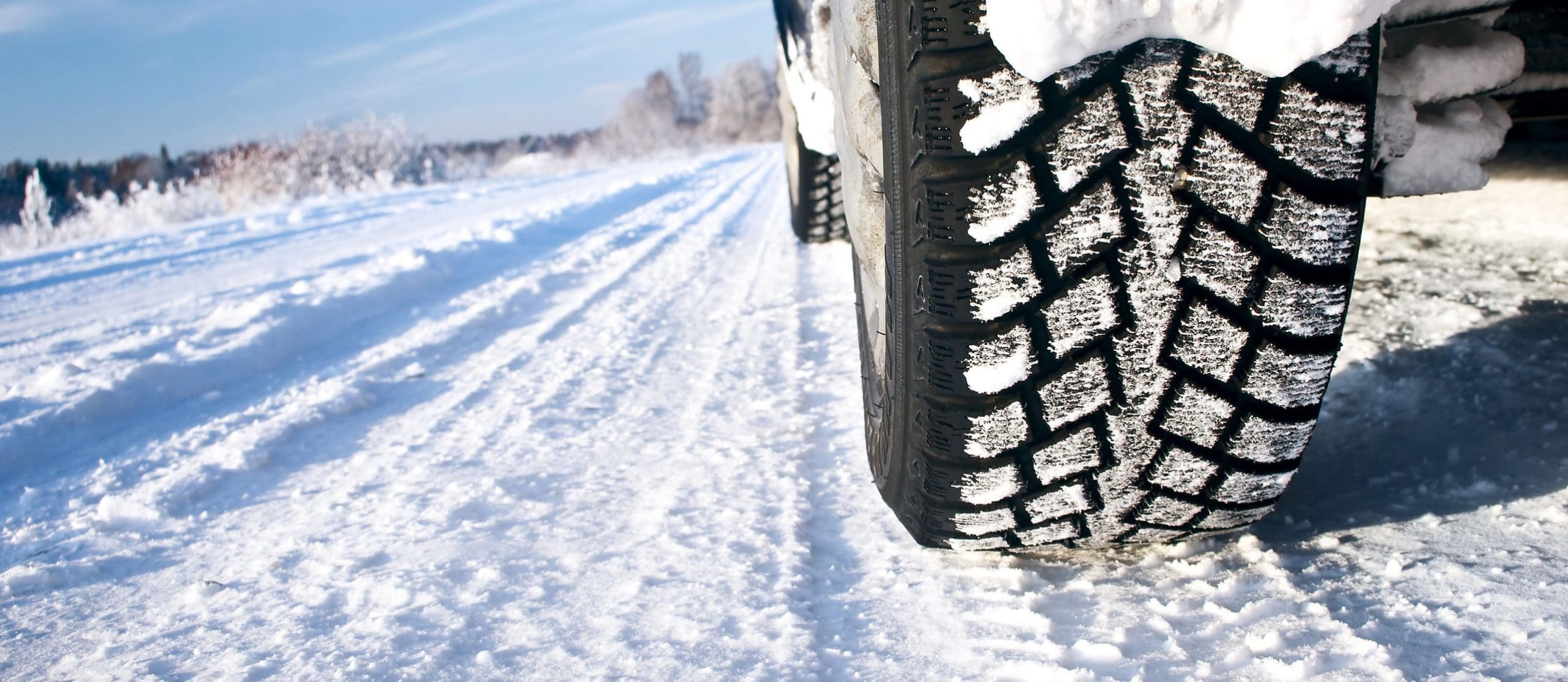 View of vehicle tires on winter morning