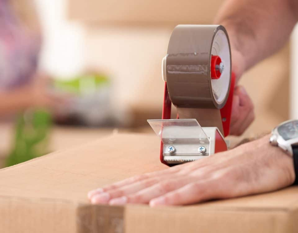 Man taping up moving box